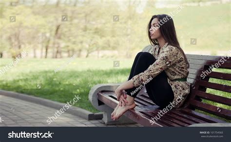 sitting on the bench beautiful girl sitting on the bench stock photo 101754583