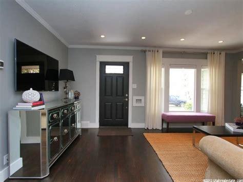 medium light grey walls with contrasting dark wood floor dark door light grey walls contrasting white dark