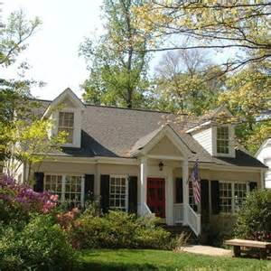 cape cod front porch ideas grey cape cod house black shutters red door curb