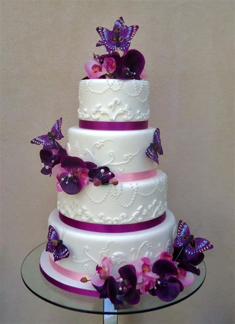 Purple accent/butterfly decor wedding cake! We can help