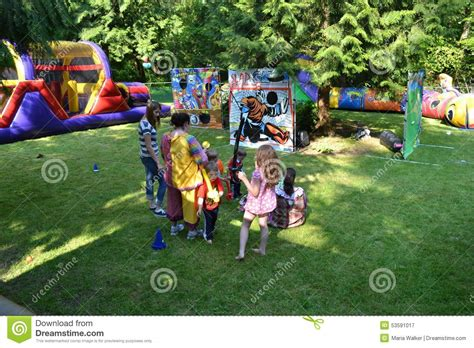 backyard birthday party games amusement park display in back yard editorial photography