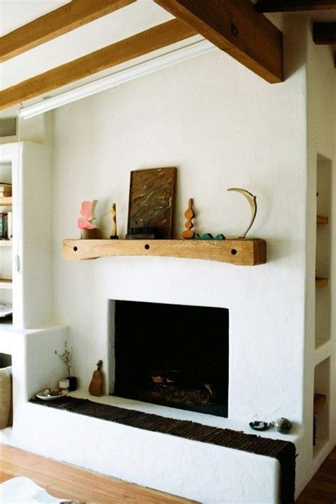 plaster fireplace beams and fireplace plaster with wooden mantle