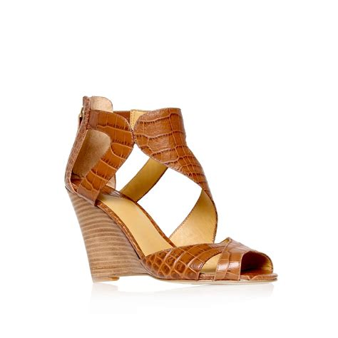 nine west sandals nine west missfitz strappy wedge sandals in brown lyst