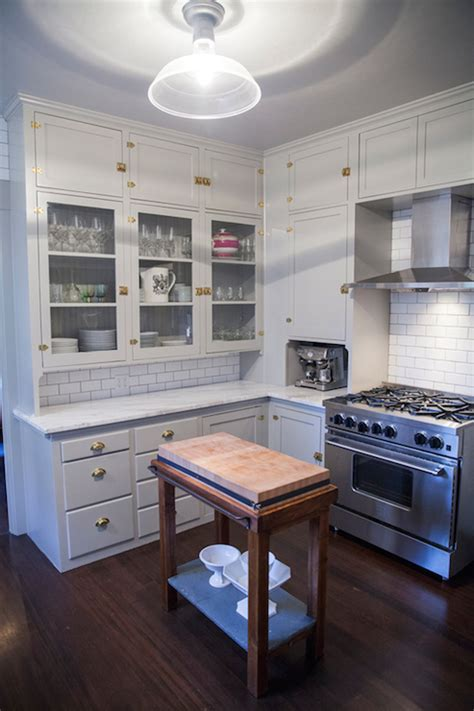 gray freestanding kitchen island with shelf and wood