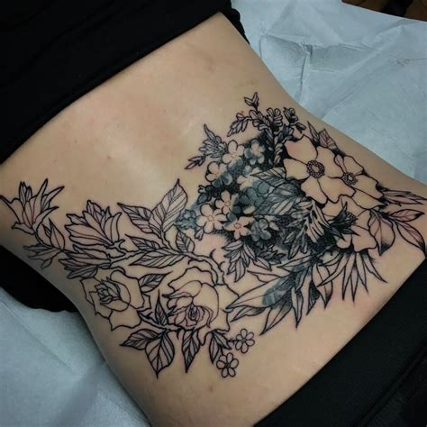 lower back tattoo the start of a stunning coverup photo 19 lower back