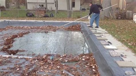 how to get leaves off your pool cover youtube