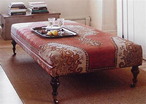 rug covered ottoman another ottoman covered with a vintage rug it functions equally well as a table and