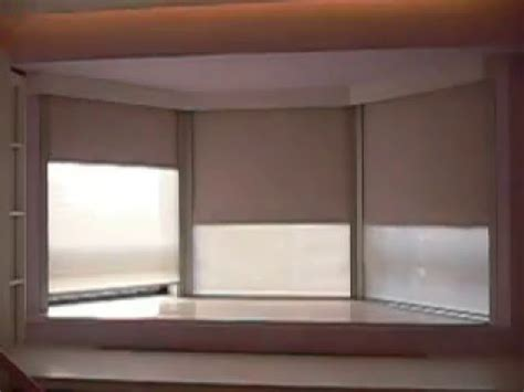 Bow Window Cost 6 motorized roller blinds install in a bay window with