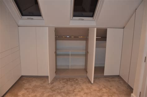 storage solutions for attic bedrooms attic room wardrobe storage with push to open doors east