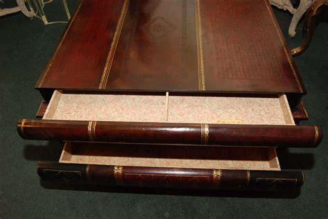 maitland smith stacked books coffee table with drawers at