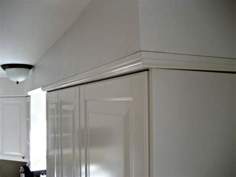 adding crown molding to ikea cabinets crown to quot join quot the cabinets to the soffit awesome idea