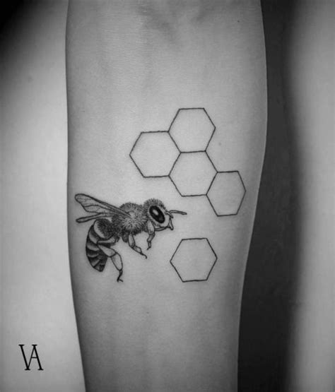 fine line tattoo artists line style bee on the left forearm