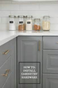 Upgrading Kitchen Cabinets how to choose and install gold hardware pulls in your