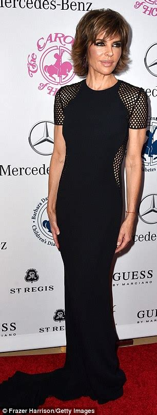 dresses lissa rinna wesrs on housewives blue cut out dress yolanda foster and lisa rinna wear the same black gown to