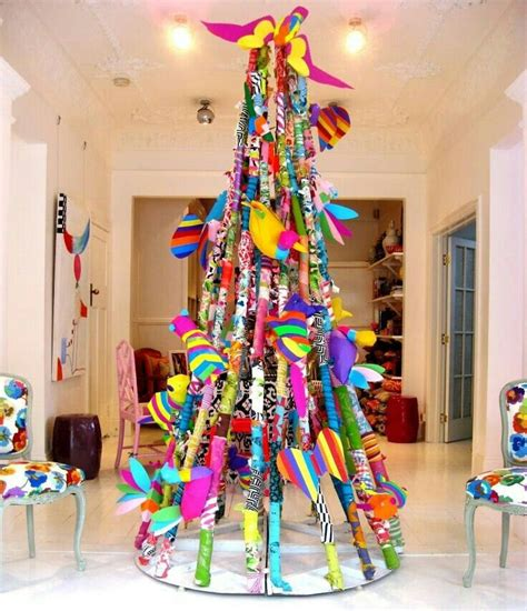 christmas tree artwork attached to strings wire that are