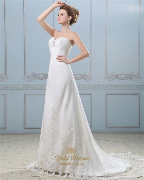 ivory strapless sweetheart empire wedding dress with
