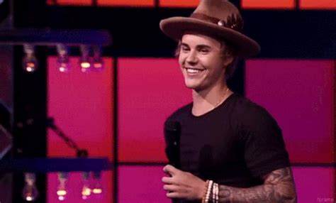 justin bieber awkwardly explains his selena gomez tattoo justin bieber hi gif tumblr