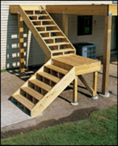 building deck stairs with a landing building patio