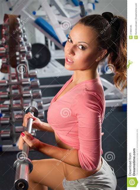only bench press girl in gym bar bench press royalty free stock photo