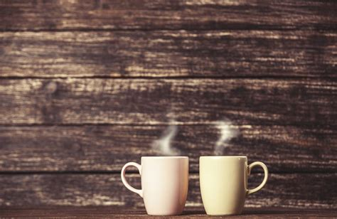m two cups of coffee on wooden table 000044323704 large