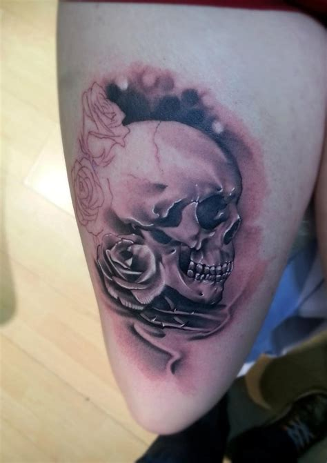 skull with roses tattoo meaning meanings and ideas of popular skull designs