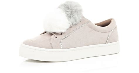 river island light pink pom pom trainers in pink lyst