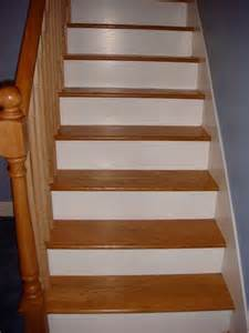 These oak stairs have painted white sides and stairskirts