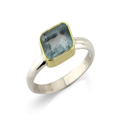aquamarine and silver ring set in 18ct gold by argent of