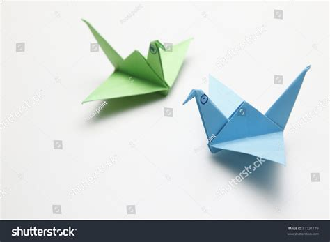 Folded Origami - paper folded animal origami bird stock photo 57731179