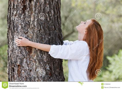 beautiful woman by the tree looking up stock photo image beautiful woman showing her love of nature stock images