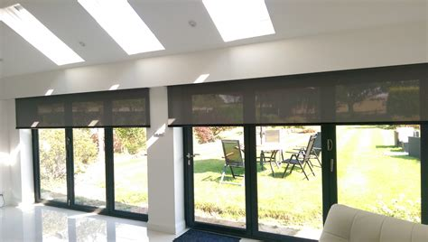 automatic curtains and blinds electric roller blinds for byfold doors hidden behind a