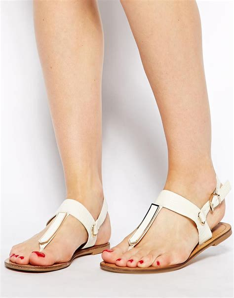 white cath flat sling back sandals lyst aldo slingback metal flat sandals in white