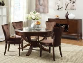 Round pedestal dining table set in brown cherry by dining rooms outlet