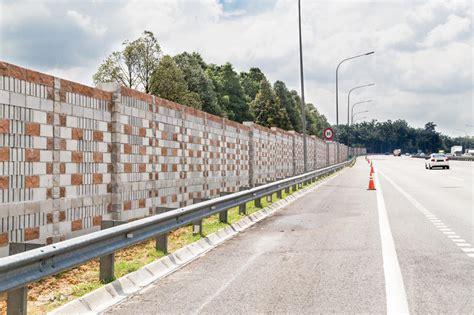 concrete noise barrier wall  busy noisy highway stock