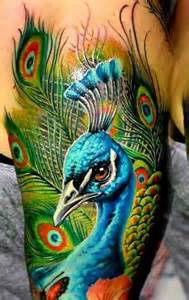 lower back tribal tattoos 61 beautiful peacock tattoo pictures and designs piercings models