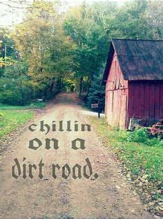 dirt road country road on the road again trees grey snow winter of nature ol and roads on