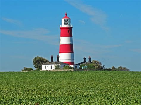 Houses Of Light by Norfolk Lighthouse And Piers Including Happisburgh