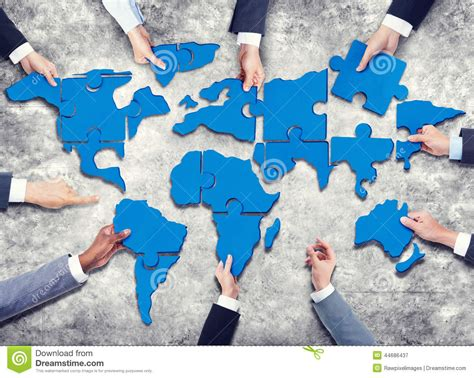 printable jigsaw map of the world group of business people with jigsaw puzzle forming in