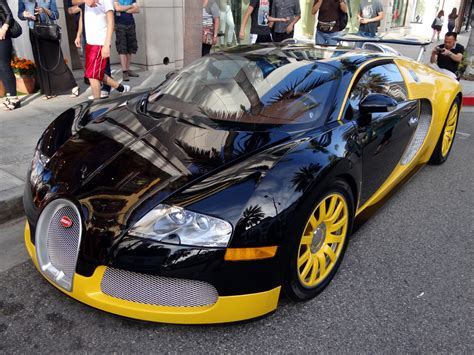 yellow bugatti custom yellow black bugatti veyron spotted in beverly