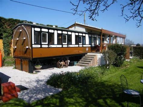 railway carriage house house critic
