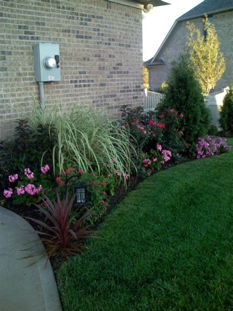 landscaping ideas for the side of the house knockout roses landscaping ideas flowers i planted are geraniumspetunia s impatients