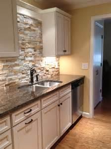 pictures of stone backsplashes for kitchens stone kitchen backsplash with white cabinets design