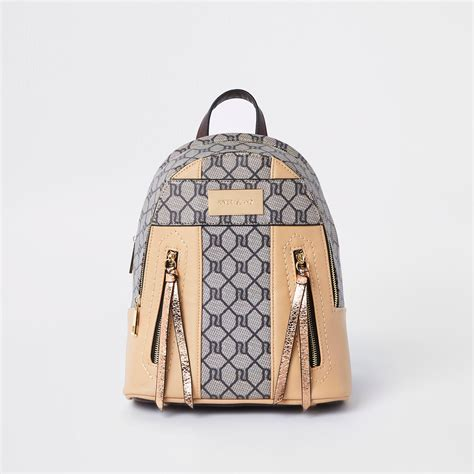river island ri monogram mini backpack  natural lyst