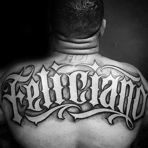 last name tattoos for men back last name negative space manly mens