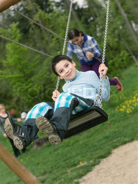 Troline Chair Walmart by Swings For Boys 28 Images Boy On A Swing Stock Image