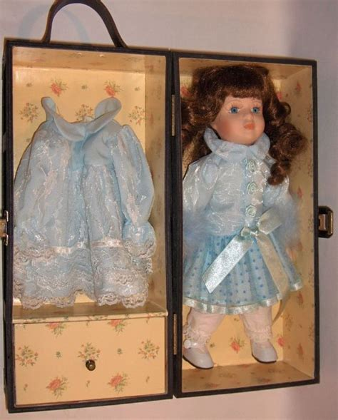 porcelain doll in wooden box blue blue dresses and curls on
