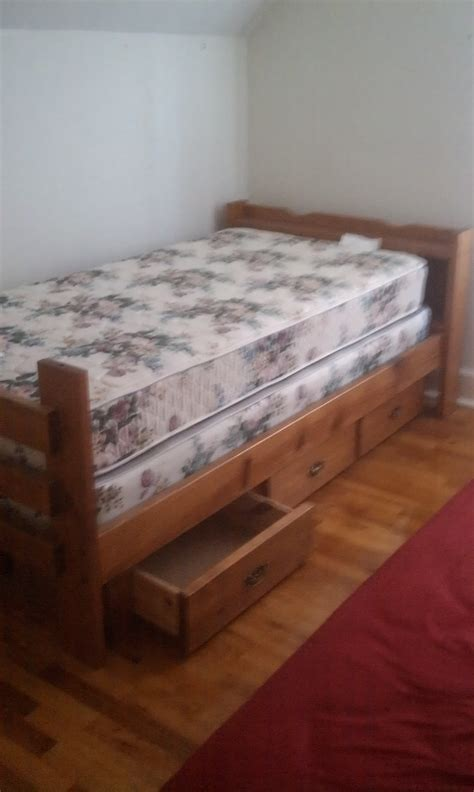 twin size wood bed frame with drawers mattress and box