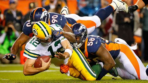 aaron rodgers of green bay packers defends leadership style broncos defense holds aaron rodgers to 77 yards passing to