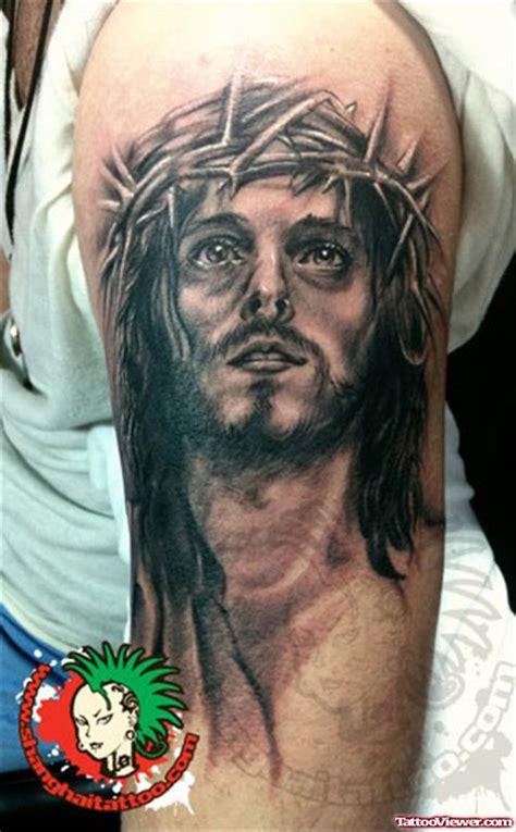 tattoo black jesus grey ink jesus tattoo on left bicep tattoo viewer com