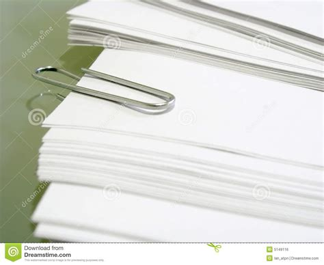 How To Make Bond Paper - pile of white bond paper with metal paper clip royalty
